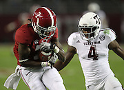 TUSCALOOSA, AL - NOVEMBER 10:  Wide receiver Kenny Bell #7 of the Alabama Crimson Tide makes a reception behind defensive back Toney Hurd Jr. #4 of the Texas A&M Aggies during the game at Bryant-Denny Stadium on November 10, 2012 in Tuscaloosa, Alabama.  (Photo by Mike Zarrilli/Getty Images)