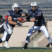 Yale Quarterback Morgan Roberts hands off to running back Tyler Varga during the Yale Vs Princeton, Ivy League College Football match at Yale Bowl, New Haven, Connecticut, USA. 15th November 2014. Photo Tim Clayton