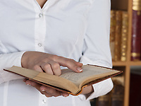 woman reading holding ancient book