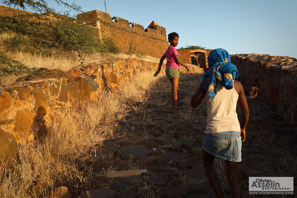 Two girls hike up a paved path to the fortress of Forte Real de Sao Filipe in Cidade Velha, Cape Verde on Sunday December 26, 2010. The fortress was built by the Portuguese in 1585.