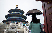 A Chinese woman protects herself from the sun's rays using an umbrella in the Temple of Heaven Tian Tan in Beijing, China, July 20, 2014. <br /> <br /> Pale skin has historically been prized as beautiful in China, and the concept is widespread in other Asian countries. Besides health topics, beauty is one of the main reasons that makes protection from the sun's rays so important. <br /> <br /> © Giorgio Perottino