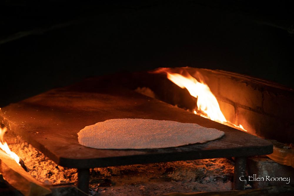 Flatbread baking in a wood fired oven at the Hardanger Folk Museum in Utne, Norway, Vestlandet, Europe