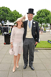 The HON.HARRY HERBERY and his wife CHICA at the Investec Derby at Epsom Racecourse, Epsom, Surrey on 4th June 2016.
