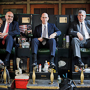 Kevin Tucker have been polishing men's shoes for 17 years right there at the entrance of Grand Central located on 42 street...Jeffrey S, C. Edward and Augie are co-workers from Norfolk Southern Corporation and come usually to polish their shoes.