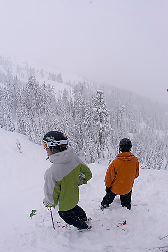 Two young men riding at Kirkwood ski resort near Lake Tahoe, CA.