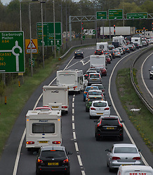 © Licensed to London News Pictures. 14/04/2017. YORK, UK.  Traffic queues along the A64 Leeds to Scarborough road near York as people get away for the Bank Holiday weekend.  Photo credit: Anna Gowthorpe/LNP