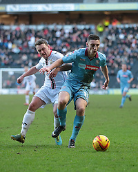Tranmere Rovers' Jake Cassidy is challenged by Milton Keynes Dons' Lee Hodson - Photo mandatory by-line: Nigel Pitts-Drake/JMP - Tel: Mobile: 07966 386802 01/02/2014 - SPORT - FOOTBALL - Stadium MK - Milton Keynes - MK Dons v Tranmere Rovers - Sky Bet League One