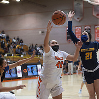 Gallup Bengal Hailey Long (40) and Highland Hornets Desiree Bachicha (21) and Aaliyah Neibrez (23) reach for a loose ball during their New Mexico Class 4A girls basketball quarterfinal game at Gallup High School in Gallup Tuesday.