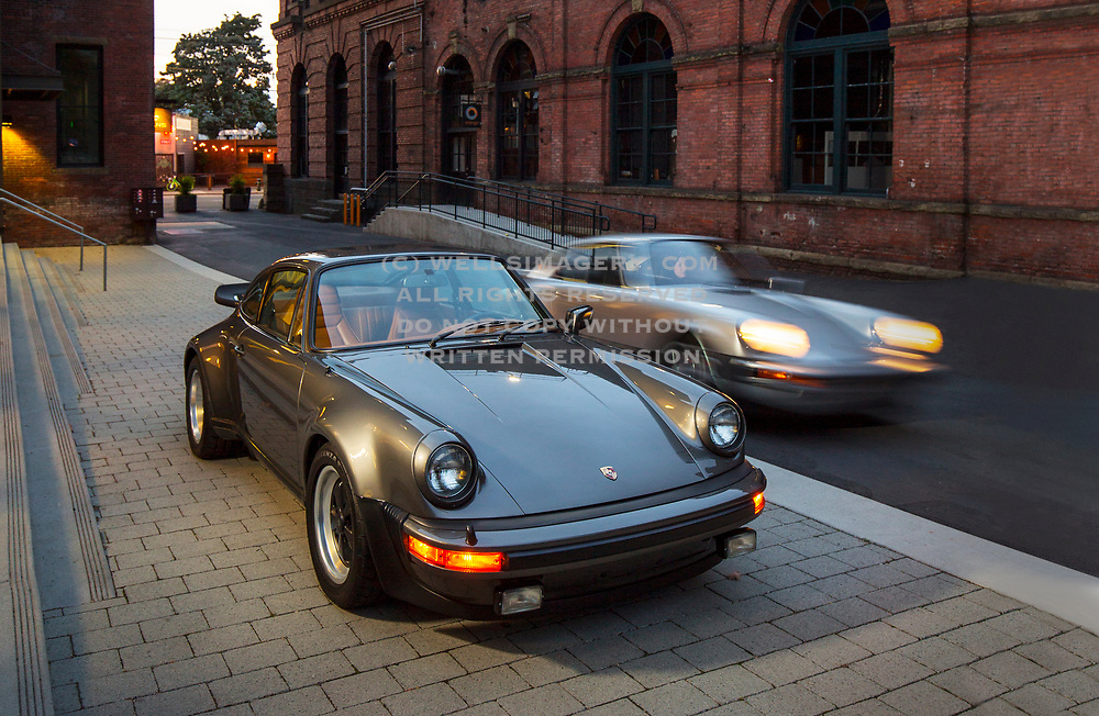 Image of a Silver 1976 Porsche Carrera 2.7 MFI 911 and a Anthracite Metallic 1977 Porsche Turbo 3.0 930 in Seattle, Washington, Pacific Northwest by Randy Wells