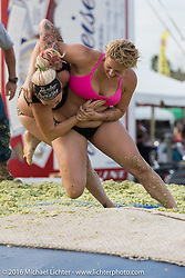 Stefanie Lowe and Lura Barker in the final round of the Womens Cole Slaw Wrestling at Sopotnicks Cabbage Patch Bar, New Smyrna Beach, during Daytona Bike Week's 75th Anniversary event. FL, USA. Saturday March 12, 2016.  Photography ©2016 Michael Lichter.
