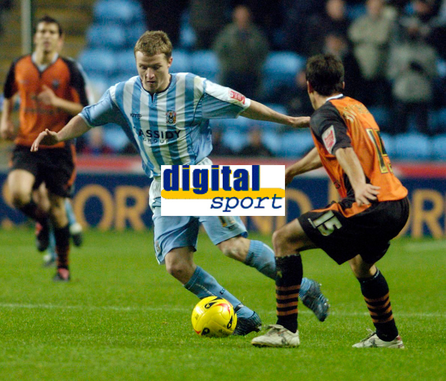 Photo: Leigh Quinnell.<br /> Coventry City v Ipswich Town. Coca Cola Championship.<br /> 19/11/2005. Coventrys Gary McSheffrey swings the ball away from Ipswichs' Sito Castro.