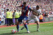 Connor Wickham of Crystal Palace blocks the ball from Phil Bardsley of Stoke City. Barclays Premier League match, Crystal Palace v Stoke City at Selhurst Park in London on Saturday 7th May 2016. pic by John Patrick Fletcher, Andrew Orchard sports photography.