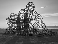 LOVE from: Odessa, Ukraine year: 2015<br /> <br /> LOVE is a sculpture by Alexandr Milov. It demonstrates a conflict between a man and a woman as well as the outer and inner expression of human nature. The figures of the protagonists are made in the form of big metal cages, where their inner selves are captivated. Their inner selves are executed in the form of transparent children , who are holding out their hands through the grating. As it's getting dark (night falls) the children chart to shine. This shining is a symbol of purity and sincerity that brings people together and gives a chance of making up when the dark time arrives. Contact: takoe.tm@gmail.com