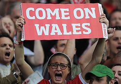 Wales fan in the crowd sings. - Photo mandatory by-line: Alex James/JMP - Mobile: 07966 386802 - 12/06/2015 - SPORT - Football - Cardiff - Cardiff City Stadium - Wales v Belgium - Euro 2016 qualifier