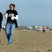 (PSUNDAY) Manasquan 10/25/2003   Sheila O'Shea of Belmar and Brittany North of Sea Girt laugh and have a good time collecting trash from the Manasquan Inlet Beach.    Michael J. Treola Staff Photographer......MJT