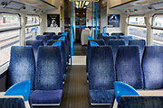 "The UK Chancellor Rishi Sunak has said today it is ""very likely"" the UK is in a ""significant recession"" due to the Coronavirus pandemic lockdown, as figures show the economy contracting at the fastest pace since the financial crisis. Empty seats in a train carriage travelling through south London towards Victoria station, on 13th May 2020, in London, England."