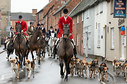 © Licensed to London News Pictures. 26/12/2019. Market Bosworth, UK. The traditional Boxing Day Hunt meet taking place in Market Bosworth, Leicestershire. Over forty horses and a pack of hounds took to the surrounding streets of Market Bosworth. In recent years anti hunt protesters have been present but the hunt took place without protest.<br /> Photo credit: Dave Warren/LNP