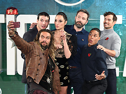 Jason Mom, Ezra Miller, Gal Gadot, Ben Affleck, Ray Fisher and Henry Cavill attending the Justice League Photocall at The College, London. Picture credit should read: Doug Peters/Empics Entertainment