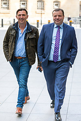 © Licensed to London News Pictures. 23/04/2017. London, UK. Millionaire UKIP donor ARRON BANKS (R) arrives at Broadcasting House to appear on Sunday Politics. Banks intends to stand for election as an MP in Clacton, the seat currently held by former UKIP MP and rival Douglas Carswell who will not stand for reelection in the 8 June General Election. Photo credit: Rob Pinney/LNP