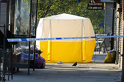 © Licensed to London News Pictures. 22/09/2021. London, UK. A police tent on Green Lanes, Haringey in north London following a fatal shooting. Police were called just after 10.30 pm on Tuesday 21, September to reports of a man shot on Green Lanes, close to Turnpike Lane underground station. Officers including firearm officers, attended with the London Ambulance Service and the London Air Ambulance. Despite their efforts, a man in his early 20s was pronounced dead at the scene at 10.56pm. Photo credit: Dinendra Haria/LNP