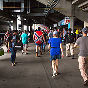 A fan with a shirt adorned with the Confederate Flag makes his way to his seat before the start of the 2016 Sprint Cup Series Coca-Cola 600 at Charlotte Motor Speedway on May 29th, 2016.