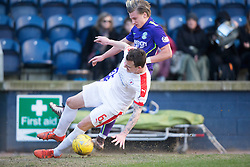 Raith Rovers Kyle Benedictus and Hibernian's Jason Cummings. <br /> Raith Rovers 2 v 1 Hibernian, Scottish Championship game player at Stark's Park, 18/3/2016.
