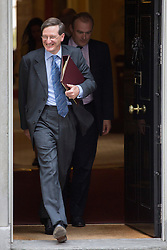 © licensed to London News Pictures. London, UK 28/08/2013. Dominic Grieve, Attorney General for England and Wales (left) leaving No10 on Downing Street, London on Wednesday, 28 August 2013 after attending a meeting of the National Security Council regarding the Syrian crisis. Photo credit: Tolga Akmen/LNP