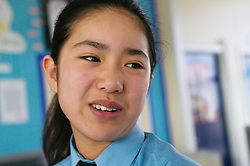 Secondary school student smiling,