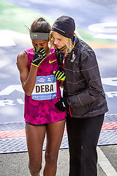NYC Marathon, Buzunesh Deba, Ethiopia, Bronx resident, hoping to win after runner-up finishes in the last 2 NYC marathons, is consoled by race director Mary Wittenberg after finishing ninth