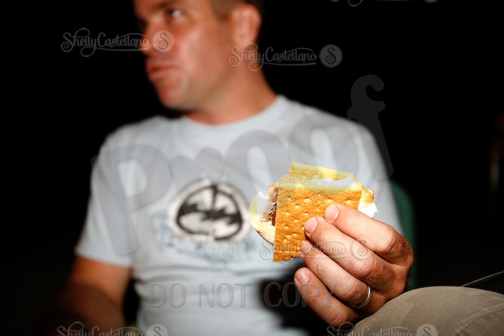 21 June 2008:  Ray Brown eats a smore.  Graham Craker sandwich with Hershey's chocolate bar and marshmellows during a beach bonfire at tower 9 in Huntington Beach, CA.