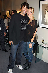 STEPHEN SOLAKA and fiance NICOLE KING at a private view of fashion designer Lindka Cierach's Couture Dresses drawn by Trudy Good held at the Belgravia Gallery, 45 Albemarle Street, London on 21st September 2005.<br />