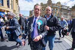 © Licensed to London News Pictures. 20/05/2019. Newcastle, UK. Nigel Farage has had what appears to be a milkshake thrown over him while campaigning in Newcastle city centre today as part of a whistle-stop tour of the UK ahead of the European elections on the 23rd May. Photo credit: Andrew McCaren/LNP
