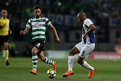April 18, 2018 - Lisbon, Portugal - Porto's Algerian forward Yacine Brahimi (R ) vies with Sporting's midfielder Bruno Fernandes from Portugal during the Portugal Cup semifinal second leg football match Sporting CP vs FC Porto at the Alvalade stadium in Lisbon on April 18, 2018. (Credit Image: © Pedro Fiuza/NurPhoto via ZUMA Press)