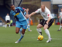 Photo: Kevin Poolman.<br />Wycombe Wanderers v Hereford United. Coca Cola League 2. 01/01/2007. Kevin Betsy of Wycombe and Simon Travis of Hereford fight over the ball.