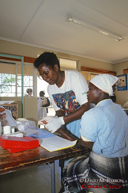 Prisca Nemapare Taking Blood From Woman
