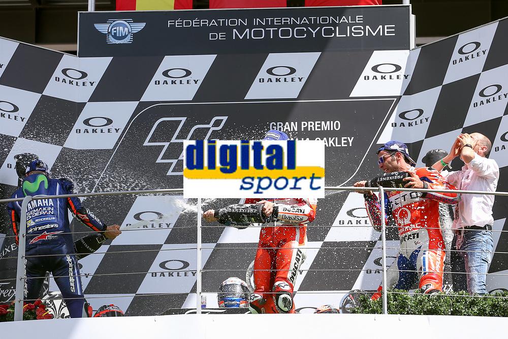 Ducati's Team rider Italian Andrea Dovizioso, winner, Maverick Vinales of Spain  and Movistar Yamaha MotoGP second, Danilo Petrucci of Italy and OCTO Pramac Racing third during the Moto GP Grand Prix at the Mugello race track on June 4, 2017 celebrates on the podium. <br /> MotoGP Italy Grand Prix 2017 at Autodromo del Mugello, Florence, Italy on 4th June 2017. <br /> Photo by Danilo D'Auria.<br /> <br /> Danilo D'Auria/UK Sports Pics Ltd/Alterphotos
