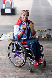 © Licensed to London News Pictures. 10/09/2012. LONDON, UK. Paralympic gold medal winning athlete Hannah Cockroft holds up her medals as she arrives at a reception for British Olympic and Paralymic athletes held at the Queen Elizabeth II Conference Centre in London today (10/09/12). Photo credit: Matt Cetti-Roberts/LNP