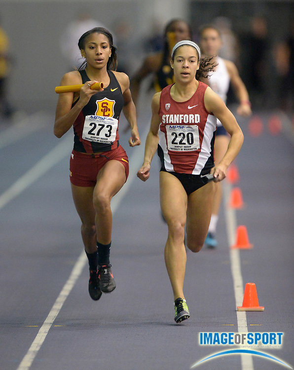 Mar 1, 2014; Seattle, WA, USA; Ashley Liverpool of Southern California (273) and Claudia Saunders of Stanford (220) run the third leg in the womens 4 x 400m relay in the 2014 MPSF Indoor Championships at the Dempsey Indoor Track.
