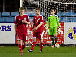 RHYL, WALES - Tuesday, March 18, 2014: Wales' goalkeeper Aaron Jones looks dejected as Poland score the second goal during the Under-15's International Friendly match at Belle Vue. (Pic by David Rawcliffe/Propaganda)