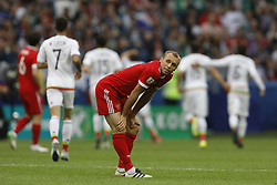 June 24, 2017 - Kazan, Russia - Denis Glushakov of Russia national team reacts as Mexico national team players celebrate a goal during the Group A - FIFA Confederations Cup Russia 2017 match between Russia and Mexico at Kazan Arena on June 24, 2017 in Kazan, Russia. (Credit Image: © Mike Kireev/NurPhoto via ZUMA Press)