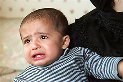 Portrait of young boy crying,