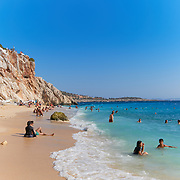 People on the Turquoise coast shoreline, Kaputas beach, Turkey