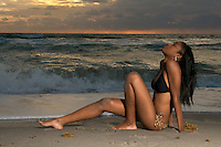 Young african american girl relaxing in the beach at sunrise.