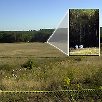 Airliner Crash Southwestern Pennsylvania<br /> PIT2001091104 - 09SEPTEMBER2001 - SHANKSVILLE, PENNSYLVANIA, USA: Investigators dressed in white and carrying yellow and red flags enters the treeline behind the crater cause by the crash of United Airlines' Flight 93 near Shanksville Pennsylvania killing all 45 people on board. ac/Archie Carpenter UPI
