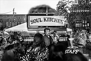Jon Bon Jovi mingles with guests during the opening of the Jon Bon Jovi Soul Foundation Soul Kitchen in Red Bank on October 19, 2011. The community kitchen serves up nutritious meals and accepts both cash and volunteer hours as payment.