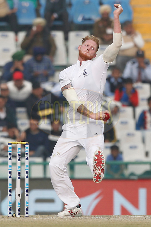 Ben Stokes of England bowls a delivery during day 4 of the third test match between India and England held at the Punjab Cricket Association IS Bindra Stadium, Mohali on the 29th November 2016.<br /> <br /> Photo by: Deepak Malik/ BCCI/ SPORTZPICS