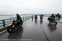 Crossing the Mackinac Bridge in the cold, rain and fog is Terry Richardson (L) on his 1946 Harley-Davidson FL Knucklehead beside Joe Ferri on his teal 1947 Indian Chief on the Cross Country Chase motorcycle endurance run from Sault Sainte Marie, MI to Key West, FL. (for vintage bikes from 1930-1948). Stage 1 from Sault Sainte Marie to Ludington, MI USA. Friday, September 6, 2019. Photography ©2019 Michael Lichter.