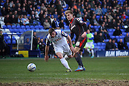 Tranmere Rovers' Steven Jennings passes the ball back under pressure from Carlisle United's Brad Potts. Skybet football league 1 match, Tranmere Rovers v Carlisle United at Prenton Park in Birkenhead, England on Saturday 29th March 2014. pic by Chris Stading, Andrew Orchard sports photography.