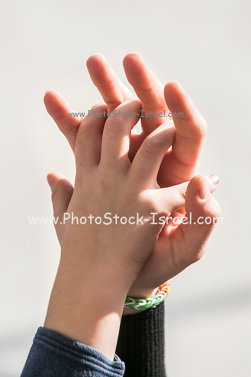 mother and child linking hands