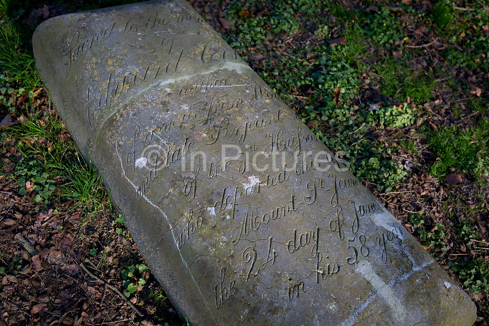 The tombstone of Sergeant-Major Edward Cotton of the 7th Hussars who helped defend the strategically-important Hougoumont Farm during the battle of Waterloo, 25th March 2017, at Waterloo, Belgium. Cotton survived the battle and returned to the area to lead battlefield tours, dying in 1849, interred here then re-buried elsewhere in 1890.The farm became an epicentre of fighting in the Battle as it was one of the first places where British and other allied forces faced Napoleons Army. 12,000 allied troops defending 14,000 French. The Battle of Waterloo was fought on 18 June 1815. A French army under Napoleon Bonaparte was defeated by two of the armies of the Seventh Coalition: an Anglo-led Allied army under the command of the Duke of Wellington, and a Prussian army under the command of Gebhard Leberecht von Blücher, resulting in 41,000 casualties.